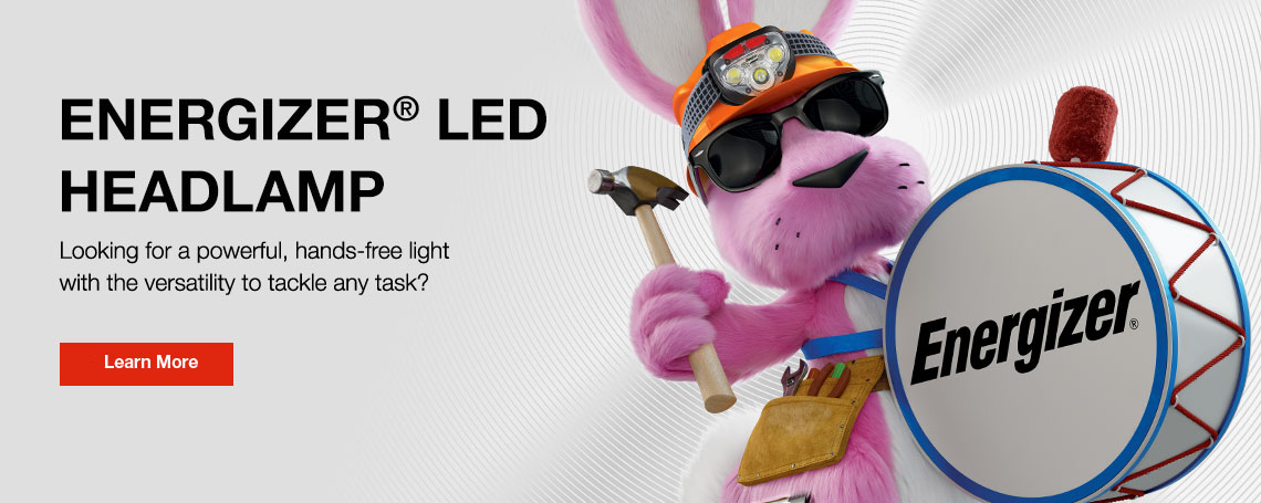 energizer bunny wearing an orange headlamp and holding a hammer with one hand and drums with the other hand